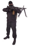 Mercenary in black uniforms with machine gun Royalty Free Stock Images
