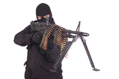 Mercenary in black uniforms with machine gun Stock Image