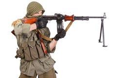 Mercenary with machine gun Royalty Free Stock Image