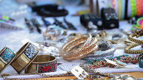 Merchandise exposed jewelery in hawker stall craft. Detail stock video