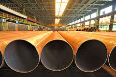 Merchandise for heavy industry steel pipes. Shoot inside of plant stock photography