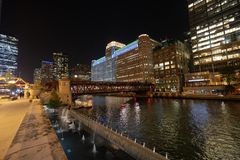Merchandise Mart in Color. Merchandise Mart lit up in colors along the Chicago River royalty free stock photos