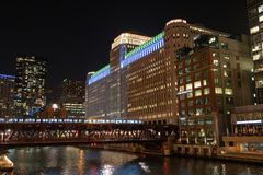 Merchandise Mart in Color. Merchandise Mart lit up in colors along the Chicago River stock images