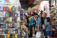Merchandise and people at the a market in Hong Kong Royalty Free Stock Photos