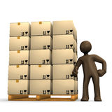 Merchandise trade, brown figurine next to a full pallet. Isolated on white background Royalty Free Stock Photos