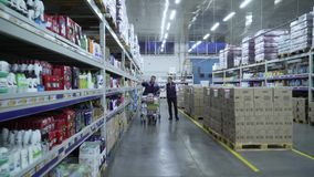 Merchandiser advises the buyer in the supermarket.  stock footage