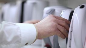 Merchandiser puts kettle. stock video