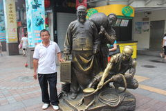 The Merchant bronze statue in the street in Guangzhou Royalty Free Stock Photo