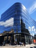 Merchant City glass building Glasgow. GLASGOW, SCOTLAND – JULY 08 2018: Redeveloped building in Merchant City area of Glasgow with its sleek contemporary stock image
