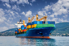 Merchant container ship. Against cloudy sky royalty free stock photo