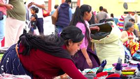 Merchant indigenous women offer clothes TAKE 2. CHIAPAS, MEXICO-CIRCA AUGUST 2018: Merchant indigenous women offer traditional clothes to the tourists in the stock video