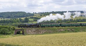 Merchant Navy Class 35006. ` Peninsular & Oriental S.N. Co ` Passes Bishops Sutton on The Mid Hants Railway. During the railway`s End of Summer Steam Gala on royalty free stock image