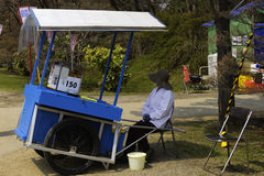 Merchant in the Park. Hirosaki Park Aomori, Japan April 15, 2016 A merchant with a cart in Hirosaki Park waits to sell food to park visitors. Editorial Use Only Royalty Free Stock Photo