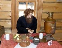Merchant return from the fair. At the inn. Museum-reserve of wooden architecture and folk art Nizhnyaya Sinyachikha, Sverdlovsk oblast, Russia royalty free stock image