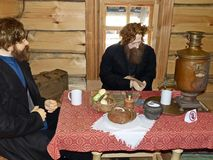Merchant return from the fair. At the inn. Museum-reserve of wooden architecture and folk art Nizhnyaya Sinyachikha, Sverdlovsk oblast, Russia stock photography