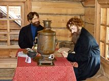Merchant return from the fair. At the inn. Museum-reserve of wooden architecture and folk art Nizhnyaya Sinyachikha, Sverdlovsk oblast, Russia royalty free stock photos