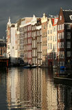 Merchant's Wealth. Monumental houses along a canal in Amsterdam in low sunlight after rain stock photography