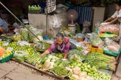 Merchant sale vegetables Royalty Free Stock Images