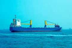 Merchant Ship. Big Industrial cargo ship on the water Royalty Free Stock Photos