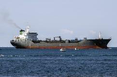 Merchant ship at sea royalty free stock photography