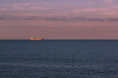 Merchant ship. Seascape with a merchant ship in the background Stock Photo