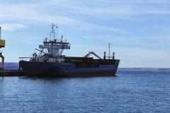 Merchant ship unloading at the dock. In Santa Pola Stock Photography