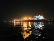 Merchant Ships at night stock photos