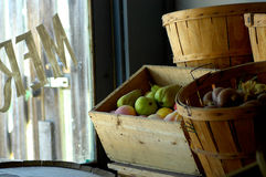 Merchant store window. Interior shot of a merchant storefront display of boxes and barrels selling fruit and other produce Royalty Free Stock Image