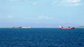 Merchant vessels and cargo container ships entering the port stock images