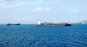 Merchant vessels and cargo container ships entering the port stock photography