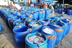 The merchants arrange the bucket which plenty of f Royalty Free Stock Photography