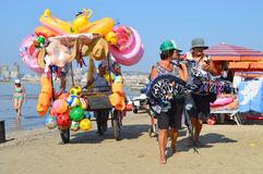 Merchants on the beach of Durres. DURRES, ALBANIA – August 31, 2015: Merchants with all kinds of goods go one after another on the beach. Albania has two faces Stock Image