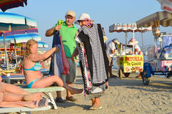 Merchants on the beach of Durres. DURRES, ALBANIA – August 31, 2015: Merchants hope to sell their goods on the beach. Albania has two faces - backwardness and Royalty Free Stock Photography