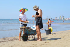 Merchants on the beach of Durres. DURRES, ALBANIA – August 30, 2015: Merchant on the beach sales grilled in a wheelbarrow sweet corn. Albania has two faces Stock Images