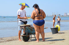 Merchants on the beach of Durres. DURRES, ALBANIA – August 30, 2015: Merchant on the beach sales grilled in a wheelbarrow sweet corn. Albania has two faces Royalty Free Stock Image