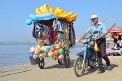 Merchants on the beach of Durres. DURRES, ALBANIA – August 31, 2015: Merchants walk one after another on the beach and sell all kind of goods. Albania has two Stock Photography
