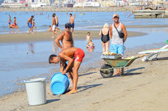 Merchants on the beach of Durres. DURRES, ALBANIA – September 01, 2015: Merchants sell food on the beach all day long. Albania has two faces - backwardness and Stock Photography
