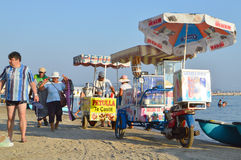 Merchants on the beach of Durres. DURRES, ALBANIA – September 01, 2015: Merchants sell food on the beach all day long. Albania has two faces - backwardness and Royalty Free Stock Photography