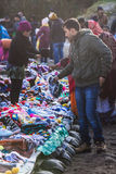 Merchants and customers with coat and hood are selling clothes on the railway in winter from Tiger Hill at Darjeeling, India Royalty Free Stock Photography