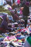 Merchants and customers with coat and hood are selling clothes on the railway in winter from Tiger Hill at Darjeeling, India Stock Photography