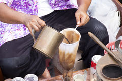 Merchants making coffee on his boat Royalty Free Stock Image