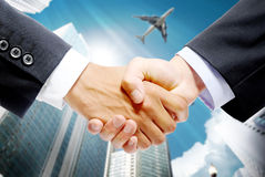 Merchants to shake hands Stock Photo