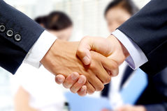 Merchants to shake hands Stock Photography