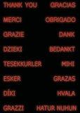 Merci dans beaucoup de langues, dans la couleur orange photo libre de droits