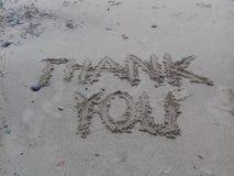 Merci dans le sable photographie stock