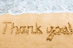 Merci exprime écrit sur la plage Image libre de droits