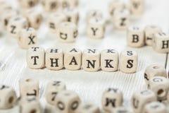 Merci expriment écrit sur le bloc en bois Images libres de droits