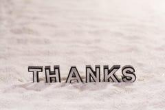 Merci expriment sur le sable blanc images libres de droits