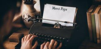 Merci far som är skriftlig på papper Fotografering för Bildbyråer