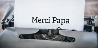 Merci far som är skriftlig på papper Royaltyfria Bilder
